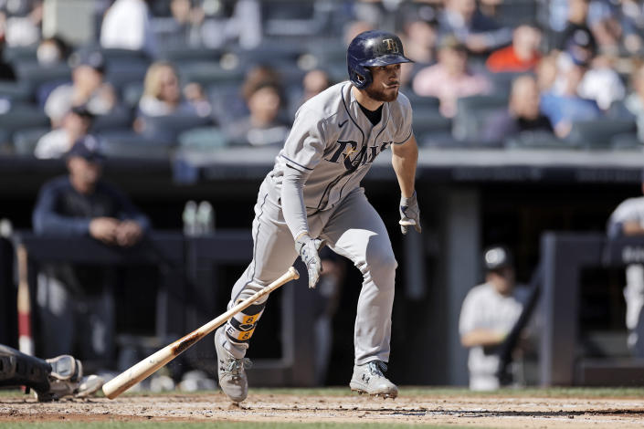 Tampa Bay Rays' Brandon Lowe hits a three-run home run during the third inning of a baseball game against the New York Yankees on Saturday, Oct. 2, 2021, in New York. (AP Photo/Adam Hunger)