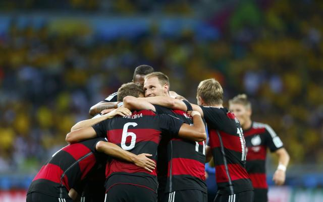 Germany's Sami Khedira (6) celebrates teammates after scoring a goal during the 2014 World Cup semi-finals between Brazil and Germany at the Mineirao stadium in Belo Horizonte July 8, 2014. REUTERS/Eddie Keogh (BRAZIL - Tags: TPX IMAGES OF THE DAY SOCCER SPORT WORLD CUP)