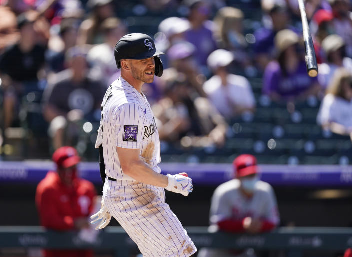 Colorado Rockies' Trevor Story flips his bat after hitting a grand slam off Philadelphia Phillies relief pitcher David Hale in the fourth inning of a baseball game Sunday, April 25, 2021, in Denver. (AP Photo/David Zalubowski)