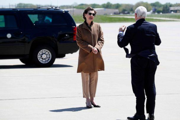 PHOTO: Vice President Mike Pence greets Iowa Gov. Kim Reynolds, left, after arriving at the Des Moines International Airport, May 8, 2020, in Des Moines, Iowa. (Charlie Neibergall/AP)
