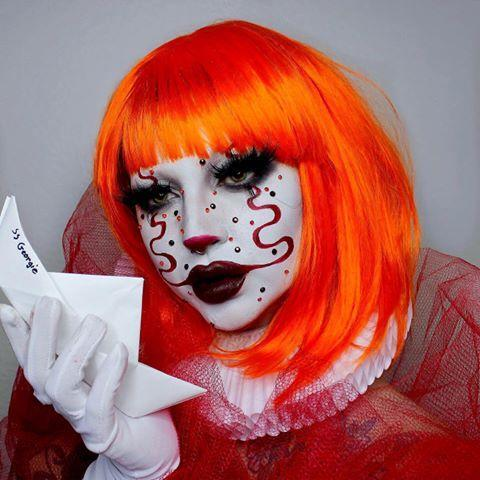 """<p>We love looks inspired by the one of the most famous—and feared—clowns in film history. And that orange wig <em>really </em>makes the whole thing rock.</p><p><a class=""""link rapid-noclick-resp"""" href=""""https://www.amazon.com/eNilecor-Straight-Synthetic-Colorful-Cosplay/dp/B01D2LIP8M/ref=sr_1_11?dchild=1&keywords=orange+wigs&qid=1600615813&sr=8-11&tag=syn-yahoo-20&ascsubtag=%5Bartid%7C10050.g.34087783%5Bsrc%7Cyahoo-us"""" rel=""""nofollow noopener"""" target=""""_blank"""" data-ylk=""""slk:SHOP ORANGE WIGS"""">SHOP ORANGE WIGS</a></p><p><a href=""""https://www.instagram.com/p/CFXO3xipSJH/?utm_source=ig_embed&utm_campaign=loading"""" rel=""""nofollow noopener"""" target=""""_blank"""" data-ylk=""""slk:See the original post on Instagram"""" class=""""link rapid-noclick-resp"""">See the original post on Instagram</a></p>"""