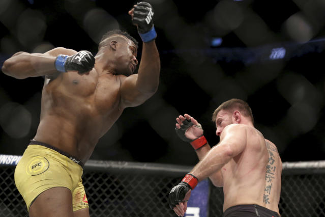 Francis Ngannou misses with an uppercut against Stipe Miocic during a heavyweight championship mixed martial arts bout at UFC 220. (AP)