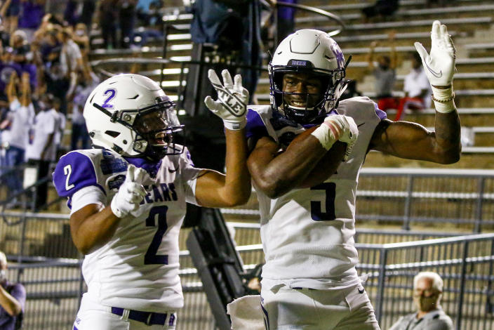Lujuan Winningham #5 celebrates with Jarrod Barnes #2 of Central Arkansas after catching the go-ahead touchdown over Austin Peay in Montgomery, Alabama. (Photo by Butch Dill/Getty Images)