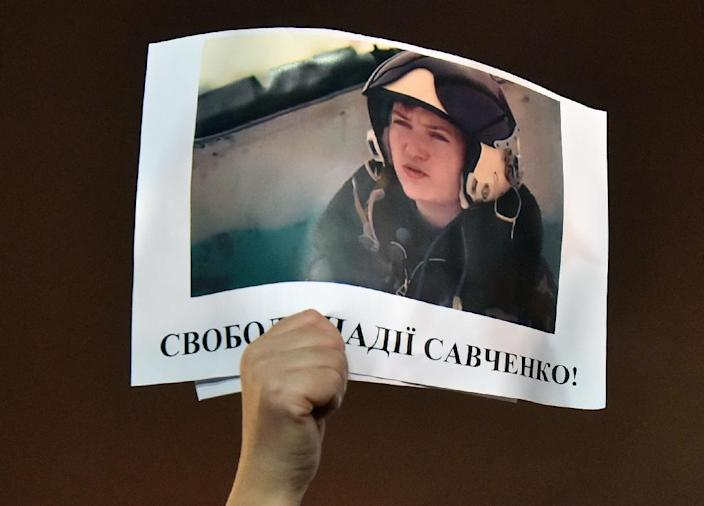 Ukrainian helicopter pilot Nadiya Savchenko is accused by Moscow of killing killing two Russian state TV journalists, while she claims she was kidnapped by pro-Moscow separatists (AFP Photo/Sergei Supinsky)