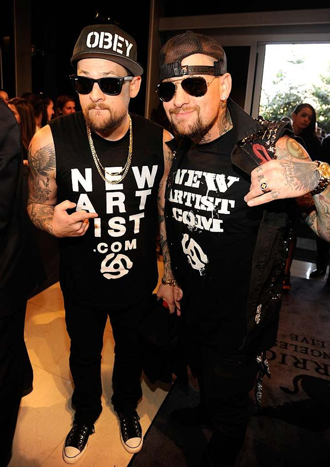 "Good Charlotte rockers/bros Joel and Benji Madden showed off their tats -- and their support for NewArtist.com. Think Joel's wife Nicole Richie would be caught wearing a tee to the bash? No way! Kevin Mazur/<a href=""http://www.wireimage.com"" target=""new"">WireImage.com</a> - August 28, 2011"