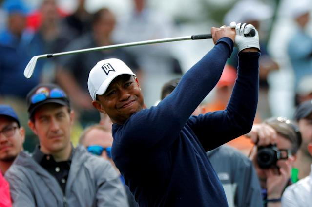 FILE PHOTO: Tiger Woods of the U.S. hits off the third tee during the final day of practice for the 2018 Masters golf tournament at Augusta National Golf Club in Augusta, Georgia, U.S., April 4, 2018. REUTERS/Brian Snyder/File Photo