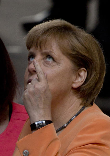 German Chancellor Angela Merkel gestures before a special session of the Germany Parliament Bundestag in Berlin, Germany, Thursday, July 19, 2012. Germany's Parliament is interrupting its summer break to vote on a rescue package worth up to euro 100 billion (US dollar 122 billion) for Spain's ailing banks. (AP Photo/Gero Breloer)
