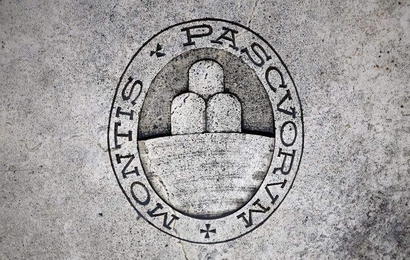 FILE PHOTO: A logo of Monte dei Paschi di Siena bank is seen on the ground in downtown Siena