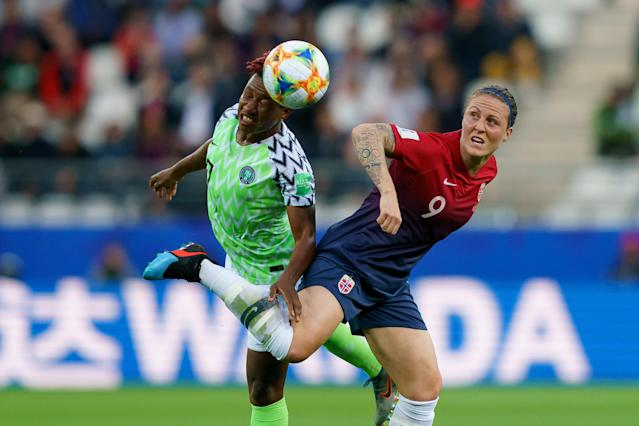 Rita Chikwelu of Nigeria and Isabell Lehn Herlovsen of Norway battle for the ball during the 2019 FIFA Women's World Cup France group A match between Norway and Nigeria at Stade Auguste Delaune on June 8, 2019 in Reims, France. (Photo by TF-Images/Getty Images)