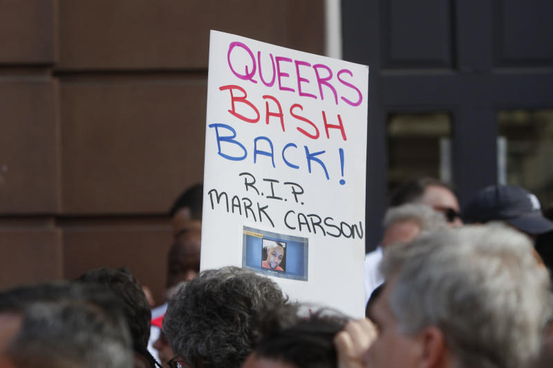 Members of the LGBT community and their supporters gather to speak out after a string a bias attacks, including the fatal shooting of 32-year old Mark Carson on Saturday, during a rally in New York's Greenwich Village, Monday, May 20, 2013. A spate of hate-fueled attacks on gay men in New York, including a killing last week on a busy street in one of Manhattan's most gay-friendly neighborhoods, has prompted outcry and soul-searching about enduring bias after gay-rights advances in recent years. (AP Photo/Jason DeCrow)
