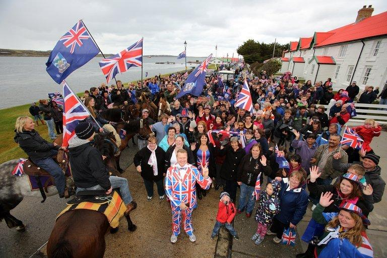 Residents gather in Stanley, the capital of the Falkland Islands, on March 10, 2013, during a referendum. Polls closed in the Falkland Islands on the first day of a two-day vote intended to show the world that the residents want to stay British amid increasingly bellicose claims by Argentina