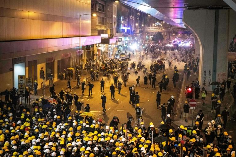 Tear gas filled Hong Kong's commercial district on Sunday (AFP Photo/Laurel CHOR)