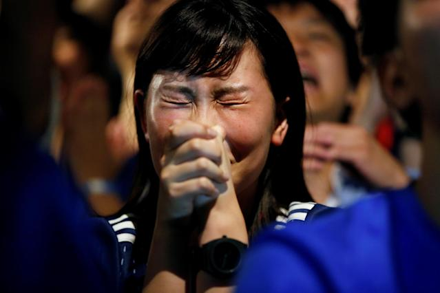 <p>Japanese fan reacts as she watches a broadcast of the World Cup Round of 16 soccer match Belgium vs Japan at a sports bar in Tokyo, Japan July 3, 2018. REUTERS/Issei Kato </p>