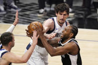 Los Angeles Clippers forward Kawhi Leonard, right, shoots as Dallas Mavericks guard Luka Doncic, left, and center Boban Marjanovic defend during the first half in Game 5 of an NBA basketball first-round playoff series Wednesday, June 2, 2021, in Los Angeles. (AP Photo/Mark J. Terrill)