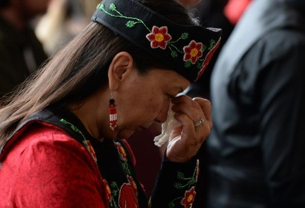 A woman listens to speakers during ceremonies marking the release of the final report of the national inquiry into missing and murdered Indigenous women and girls in Gatineau, Que., in June 2019. (Adrian Wyld/The Canadian Press - image credit)