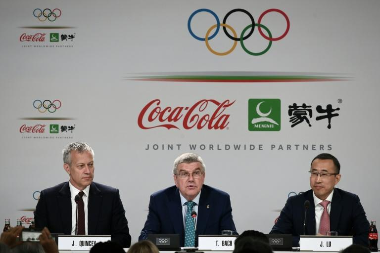 Coca-Cola CEO James Quincey (left), whose company is a historic sponsor of the Olympics, takes part in a 2019 news conference in Lausanne with International Olympic Committee president Thomas Bach (center) and China Mengniu Dairy CEO Jeffrey Minfang