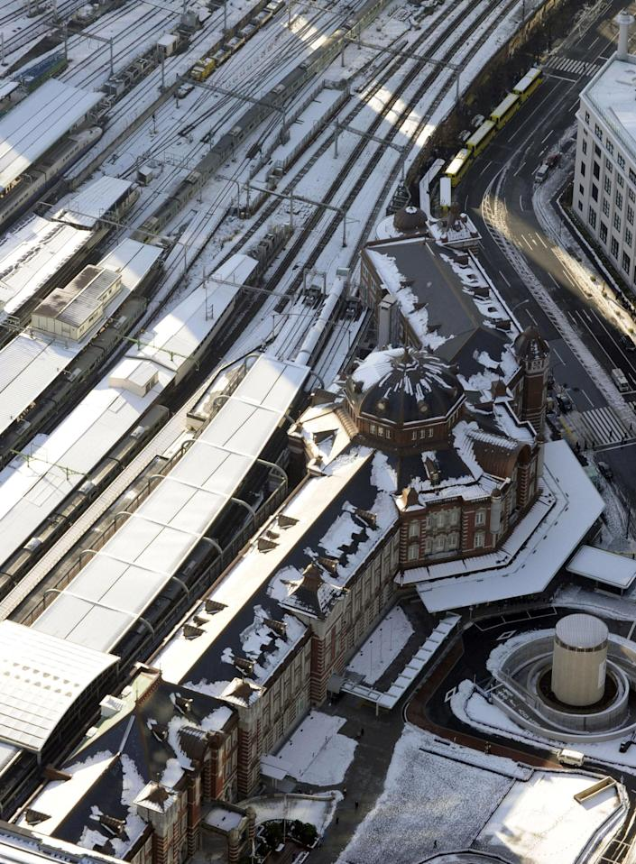 Tokyo Station is still covered with snow in Tokyo Tuesday, Jan. 15, 2013 following Monday's snowfall. In the season's first snowfall in the Japanese capital, about 8 centimeters (3 inches) of snow fell in central Tokyo and around Narita on Monday - a national holiday in Japan. The snow snarled traffic and caused train delays. (AP Photo/Kyodo News) JAPAN OUT, MANDATORY CREDIT, NO LICENSING IN CHINA, HONG KONG, JAPAN, SOUTH KOREA AND FRANCE