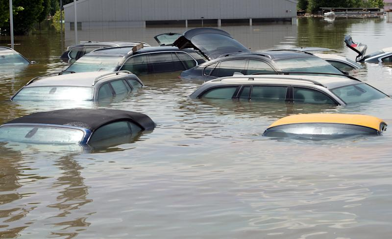 Cars stand submerged in the floodwater of the river Danube in Deggendorf, southern Germany, Friday, June 7, 2013. Heavy rainfalls in the past days cause flooding along rivers and lakes in Germany, Austria, Switzerland the Czech Republic and Hungary. (AP Photo/dpa, Peter Kneffel)
