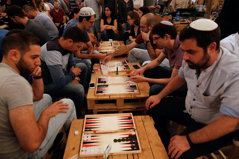Dozens of Israelis and Palestinians, gathered for a backgammon tournament on August 31, 2016