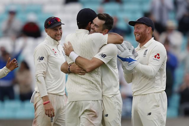 James Anderson hugs Alastair Cook after taking the final India wicket at the Oval