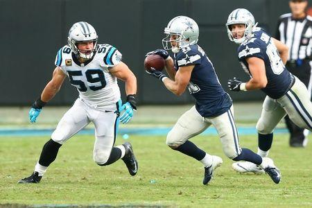 Sep 9, 2018; Charlotte, NC, USA; Dallas Cowboys wide receiver Cole Beasley (11) catches a pass against Carolina Panthers linebacker Luke Kuechly (59) in the fourth quarter at Bank of America Stadium. Mandatory Credit: Jeremy Brevard-USA TODAY Sports