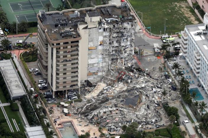 An aerial view showing a partially collapsed building in Surfside near Miami Beach