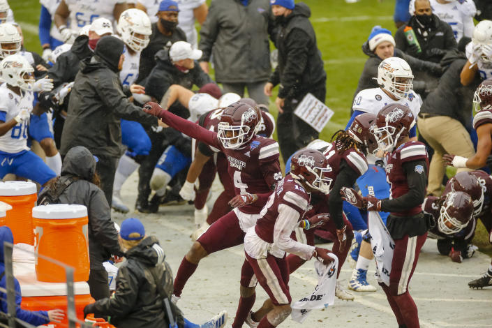 FORT WORTH, TX - DECEMBER 31: A fight breaks out after the game cancelling the trophy presentation after the Armed Forces Bowl game between the Tulsa Golden Hurricane and the Mississippi State Bulldogs on December 31, 2020 at Amon G. Carter Stadium in Fort Worth, Texas. (Photo by Matthew Pearce/Icon Sportswire via Getty Images)