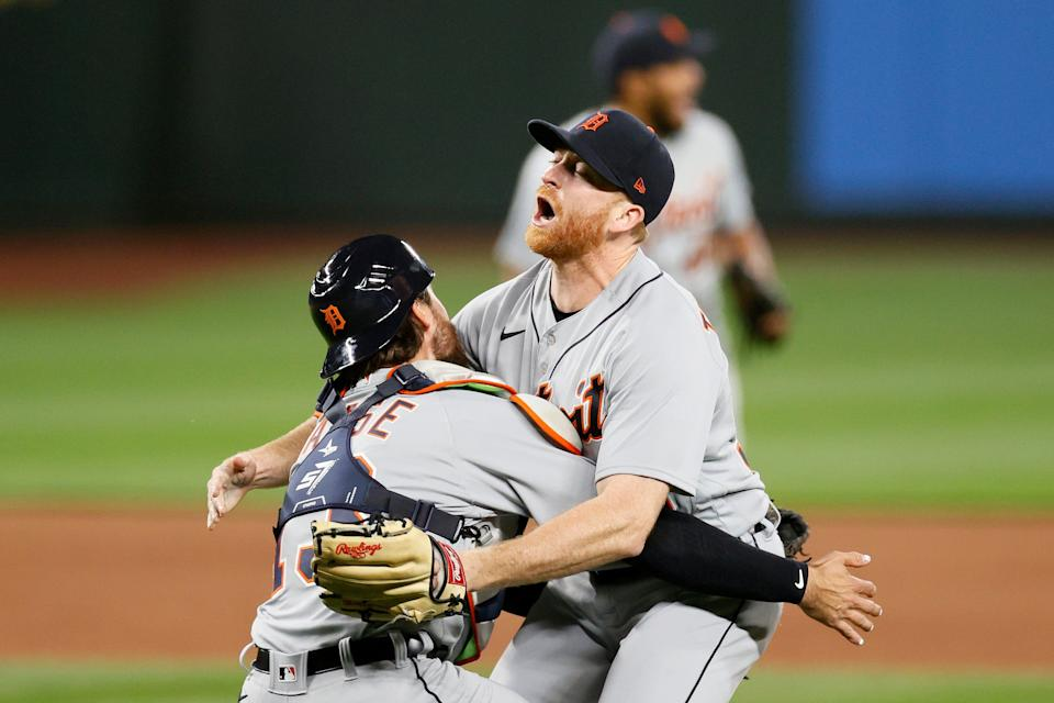 Spencer Turnbull #56 and Eric Haase #13 of the Detroit Tigers celebrate after Turnbull's no-hitter against the Seattle Mariners at T-Mobile Park on May 18, 2021.
