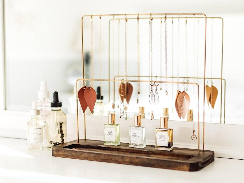 <p>With a chic wooden base and gold finish, this <span>Jewelry Stand</span> ($65) is so glamorous.</p>