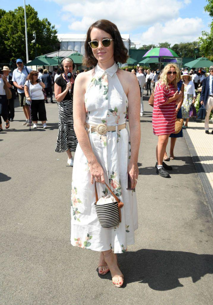<p>The Crown actress wore a sleeveless floral summer dress, accessorised with a striped bucket bag for the Championships. </p>