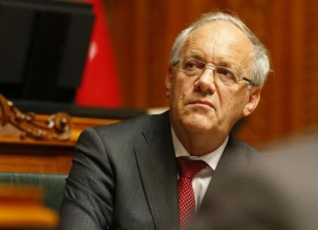 Swiss Economy Minister Schneider-Ammann follows the debate of the 'Minimal Salary' initiative in the National Council in Bern