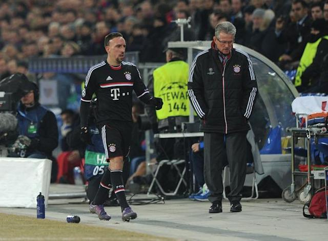 Bayern Munich's French midfielder Franck Ribery (L) walks beside Munich's headcoach Jupp Heynckes after his substitution during the UEFA Champions League round of sixteen first leg match between Bayern Munich and FC Basel in the St. Jakob stadium in Basel, Switzerland, on February 22, 2012. Munich lost the match 0-1. (Photo by Christof Stache/AFP/Getty Images)
