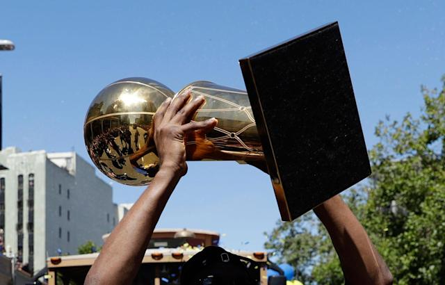 Get ready to draft so you can be holding a trophy at the end of the fantasy season. (AP Photo/Marcio Jose Sanchez)