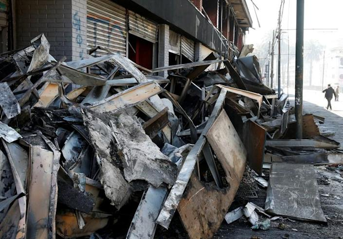 Debris of a burnt and looted supermarket are seen one day after a protest against the government in Valparaiso