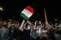Italian fans watch the Euro 2020, soccer championship group A match between Italy and Turkey, on a mega screen set in downtown Rome, Friday, June 11, 2021. (Cecilia Fabiano/LaPresse via AP)