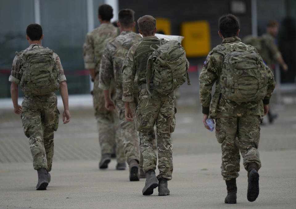 Members of the British armed forces 16 Air Assault Brigade walk to the air terminal after disembarking a RAF Voyager aircraft at Brize Norton, England, as they return from helping in operations to evacuate people from Kabul airport in Afghanistan, Saturday, Aug. 28, 2021. More than 100,000 people have been safely evacuated through the Kabul airport, according to the U.S., but thousands more are struggling to leave in one of history's biggest airlifts. (AP Photo/Alastair Grant, Pool)