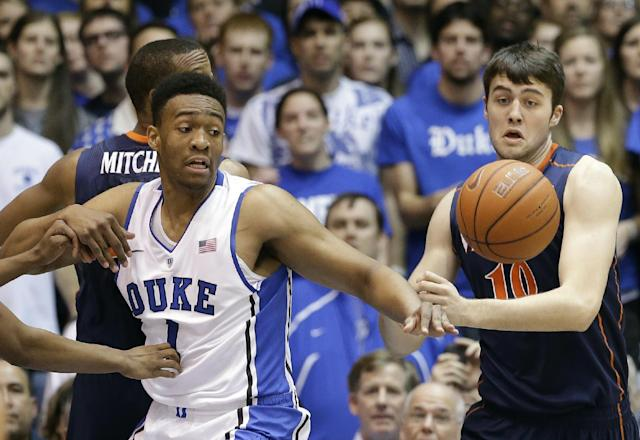 Duke's Jabari Parker (1) and Virginia's Mike Tobey (10) reach for the ball during the first half of an NCAA college basketball game in Durham, N.C., Monday, Jan. 13, 2014. (AP Photo/Gerry Broome)