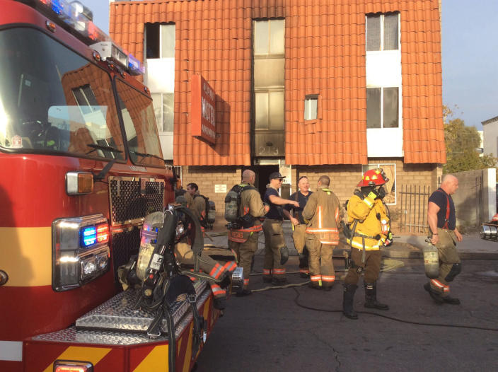 This photo provided by the Las Vegas Fire Department, firefighters work the scene of a fire at a three-story apartment complex early Saturday, Dec. 21, 2019 in Las Vegas. The fire was in first-floor unit of the Alpine Motel Apartments and its cause was under investigation, the department said. Authorities say multiple fatalities were reported and several were injured. (Las Vegas Fire Department via AP)