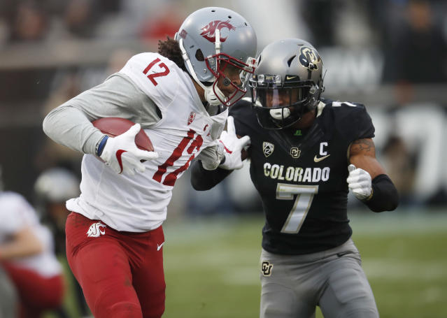 Washington State wide receiver Dezmon Patmon, left, is tackled by Colorado defensive back Nick Fisher after pulling in a pass in the second half of an NCAA college football game Saturday, Nov. 10, 2018, in Boulder, Colo. Washington State won 31-7. (AP Photo/David Zalubowski)