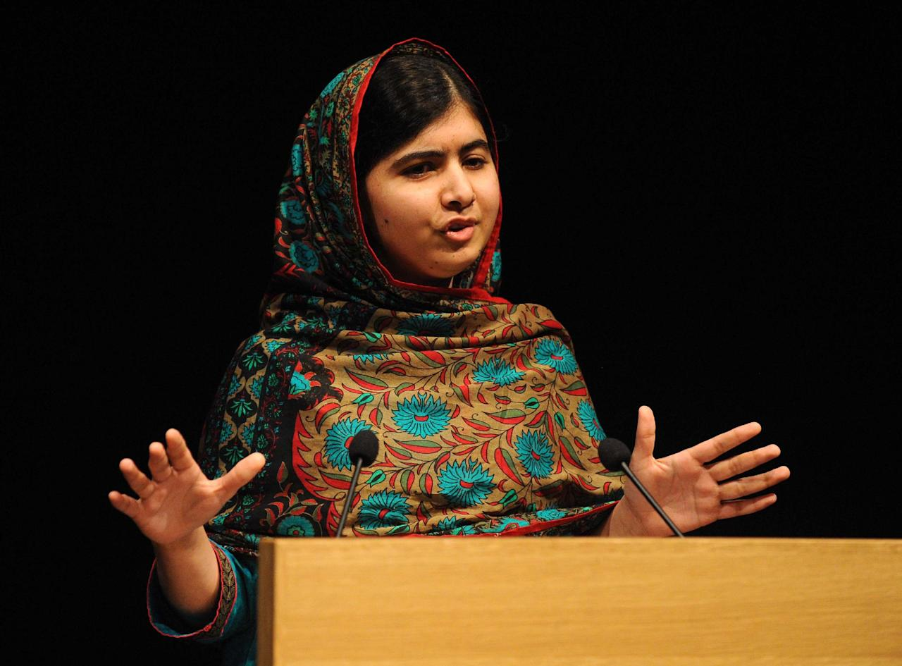 Malala Yousafzai speaks during a media conference at the Library of Birmingham, in Birmingham, England, Friday, Oct. 10, 2014, after she was named as winner of The Nobel Peace Prize. The Nobel Peace Prize 2014, is awarded jointly to Malala Yousafzai of Pakistan and Kailash Satyarthi of India, for risking their lives to fight for children's rights. Malala was shot in the head by a Taliban gunman two-years ago in Pakistan for insisting that girls have the right to an education. (AP Photo/Rui Vieira)