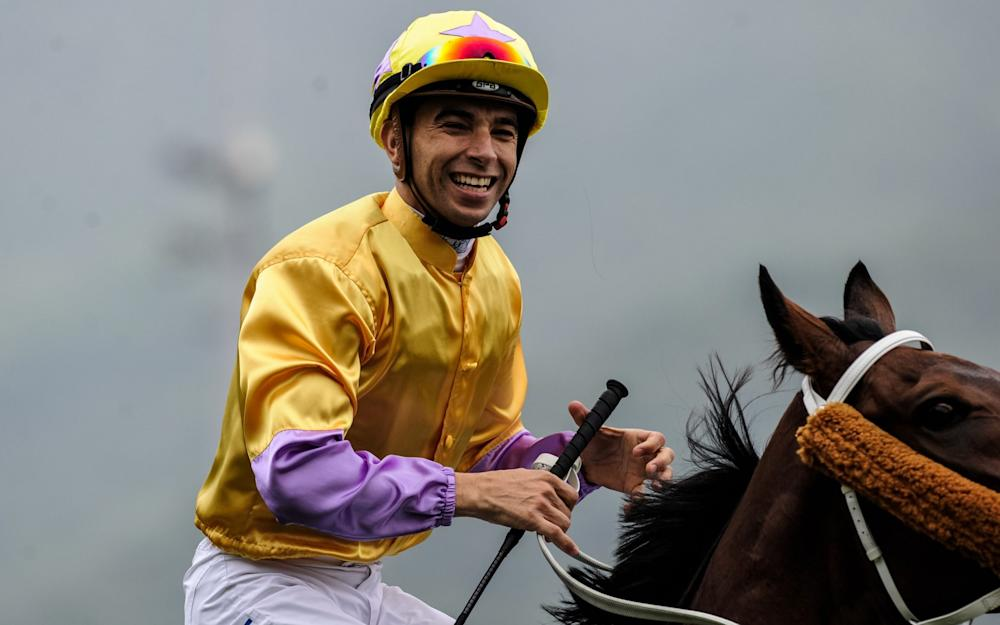 Hong Kong-based jockey Joao Moreira of Brazil celebrating after winning the 1200-metre Longines Hong Kong Sprint at the Hong Kong International Races - Credit: ANTHONY WALLACE/AFP/Getty Images