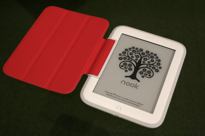 In this Monday, Oct. 28, 2013 photo, Barnes & Noble's new e-reader, Nook GlowLight, is demonstrated in New York. The GlowLight has an electronic ink touch screen, which has better battery life and less glare than typical tablet screens. The red cover is an optional accessory. (AP Photo/Mark Lennihan)