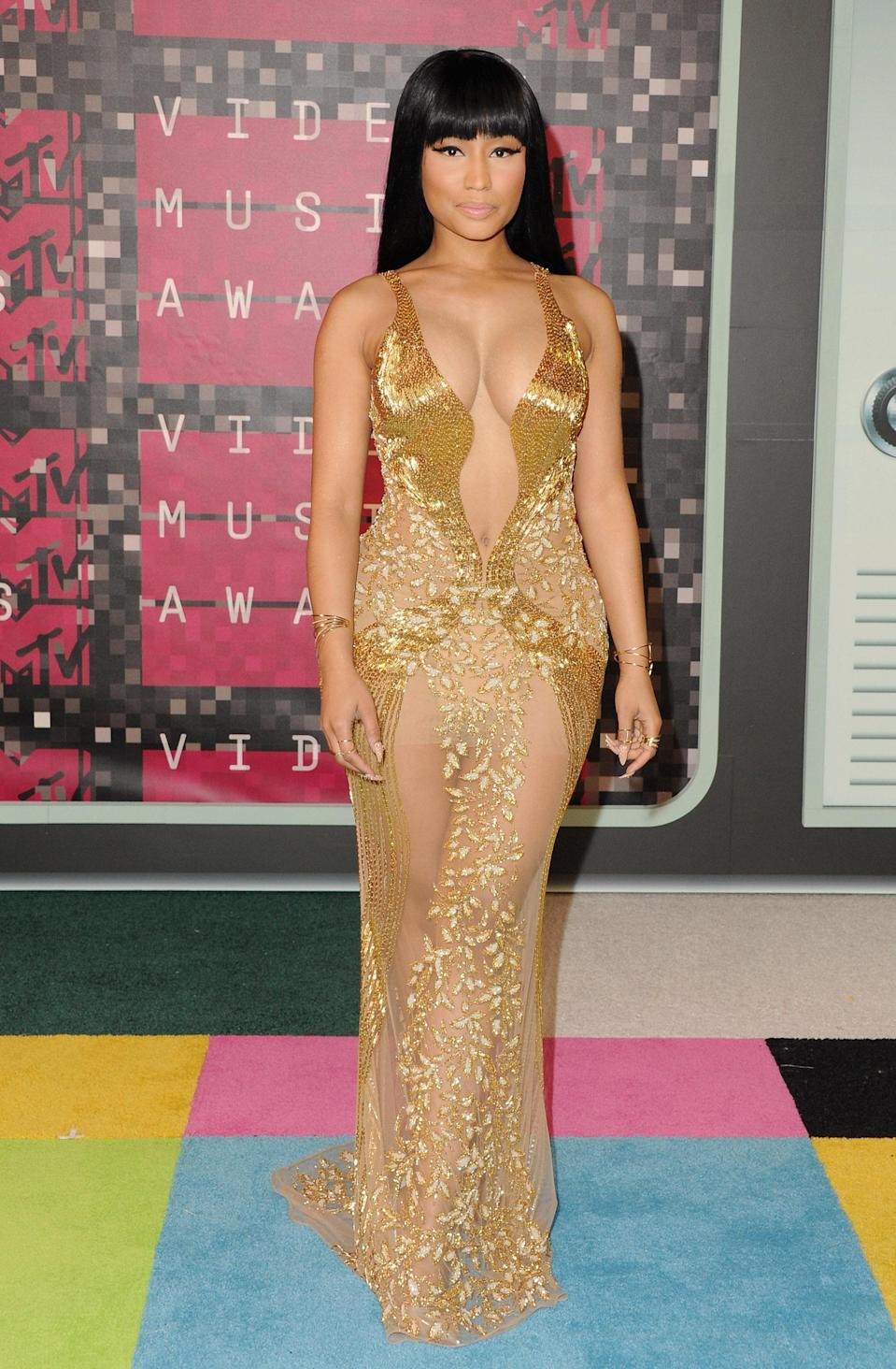 Nicki Minaj was gilded in a sheer embroidered Labourjoisie gown. Her looks from the VMAs run the entire style gamut and this was a definite favorite.