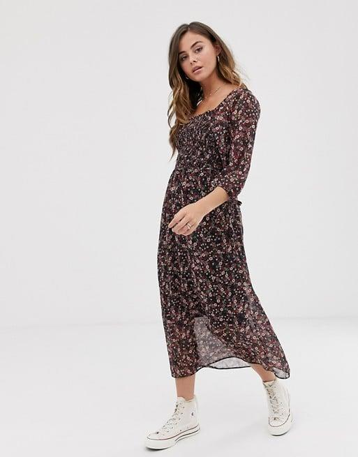 "<p>Style this <a href=""https://www.popsugar.com/buy/New-Look-Shirred-Floral-Midi-Dress-484196?p_name=New%20Look%20Shirred%20Floral%20Midi%20Dress&retailer=us.asos.com&pid=484196&price=45&evar1=fab%3Aus&evar9=44705274&evar98=https%3A%2F%2Fwww.popsugar.com%2Ffashion%2Fphoto-gallery%2F44705274%2Fimage%2F46613766%2FNew-Look-Shirred-Floral-Midi-Dress&list1=shopping%2Ctravel%2Cfall%20fashion%2Cdresses%2Cfall%2Cspring%2Csummer%2Cday%20dresses%2Ctravel%20style%2Cspring%20fashion%2Csummer%20fashion%2Cspring%20dresses&prop13=mobile&pdata=1"" rel=""nofollow"" data-shoppable-link=""1"" target=""_blank"" class=""ga-track"" data-ga-category=""Related"" data-ga-label=""https://us.asos.com/new-look/new-look-shirred-square-neck-midi-dress-in-ditsy-floral-print/prd/12418633?clr=multi&amp;colourWayId=16426724&amp;SearchQuery=floral%20dress"" data-ga-action=""In-Line Links"">New Look Shirred Floral Midi Dress </a> ($45) with sneakers or black booties.</p>"