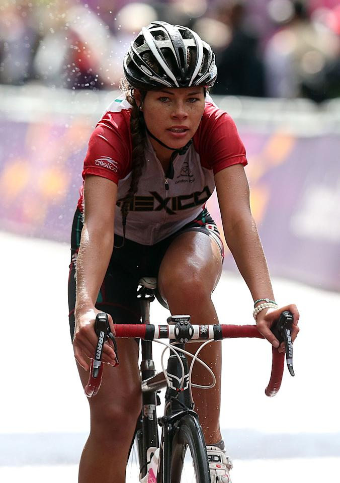 LONDON, ENGLAND - JULY 29:  Ingrid Drexel of Mexico crosses the finish line during the Women's Road Race Road Cycling on day two of the London 2012 Olympic Games on July 29, 2012 in London, England  (Photo by Bryn Lennon/Getty Images)