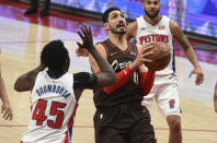 Portland Trail Blazers center Enes Kanter drives to the basket on Detroit Pistons forward Sekou Doumbouya, left, during the second half of an NBA basketball game in Portland, Ore., Saturday, April 10, 2021. The Blazers won 118-103. (AP Photo/Steve Dykes)