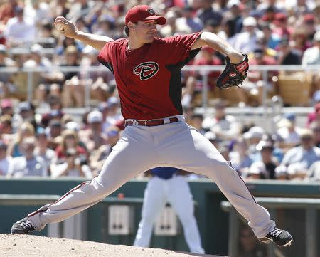 FILE PHOTO: Arizona Diamondbacks pitcher Daniel Hudson delivers a pitch during their MLB spring training game against the Los Angeles Dodgers in Glendale, Arizona April 1, 2012. REUTERS/Darryl Webb