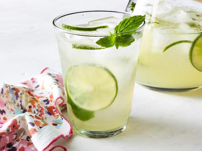 """<p><strong>Recipe: </strong><a href=""""https://www.southernliving.com/recipes/mojito-pitcher-recipe"""" rel=""""nofollow noopener"""" target=""""_blank"""" data-ylk=""""slk:Pitcher Mojitos"""" class=""""link rapid-noclick-resp""""><strong>Pitcher Mojitos</strong></a></p> <p>If mojitos are your go-to summer sipper, make them for the neighbors, too, with this big-batch recipe.</p>"""