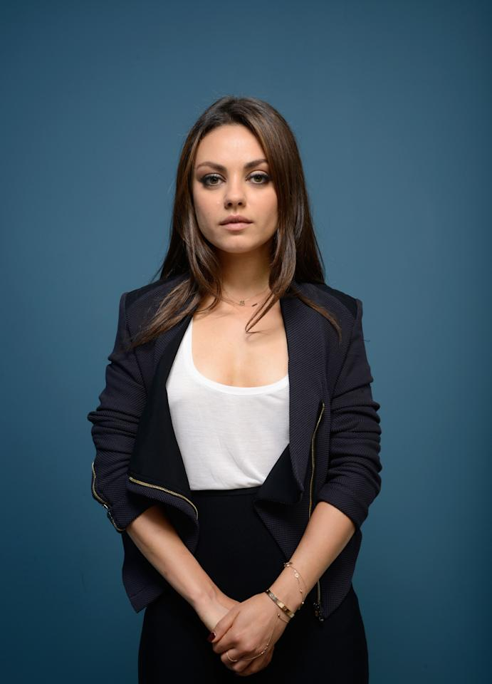 TORONTO, ON - SEPTEMBER 10: Actress Mila Kunis of 'Third Person' poses at the Guess Portrait Studio during 2013 Toronto International Film Festival on September 10, 2013 in Toronto, Canada. (Photo by Larry Busacca/Getty Images)