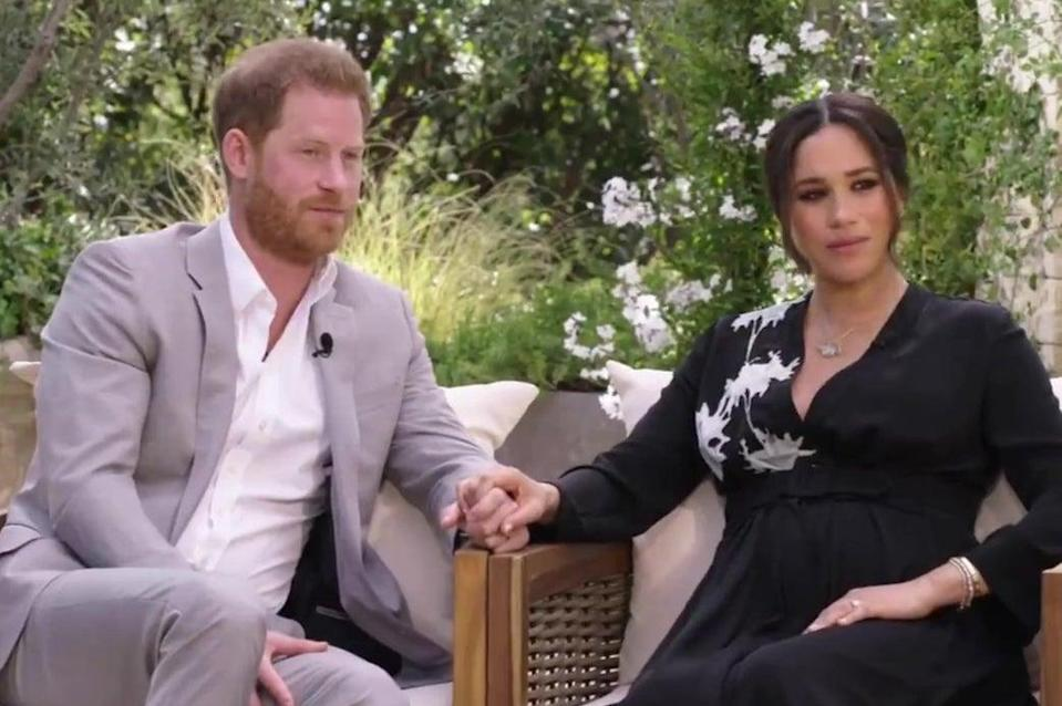<p>Prince Harry and Meghan pictured in the trailer</p> (CBS)